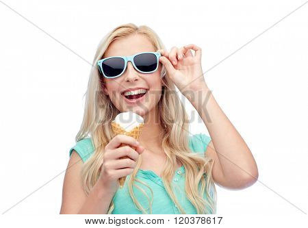 summer, junk food and people concept - young woman or teenage girl in sunglasses eating ice cream