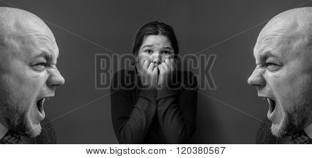 A young girl covering her ears with her hands. Angry man shouting at her. Double Exposure. Black and white photo