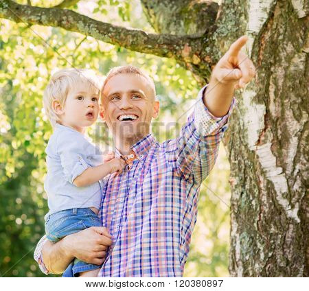 Father spending time with son in the forest.