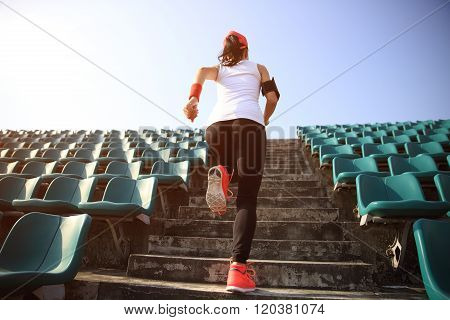 young fitness woman runner running on stairs