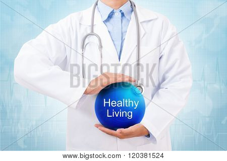 Doctor holding blue crystal ball with Healthy Living sign
