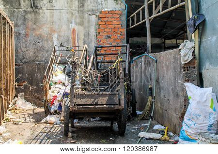 Dirty Carts With Rubbish Piles.