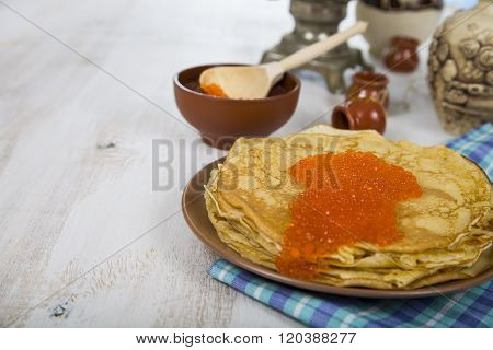 Pancakes With Red Caviar On A Table