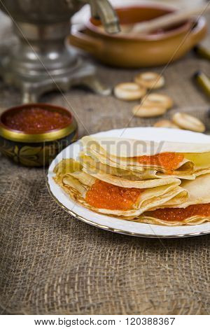 Pancakes With Caviar On The Table