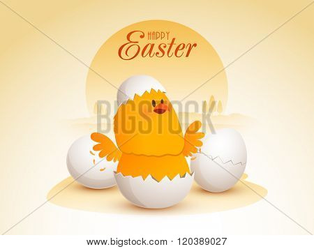 Cute Chick inside a cracked egg on nature background for Happy Easter celebration.