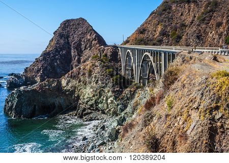 Great arch viaduct runs along the Pacific coast. California highway number 1. USA