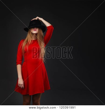 Girl Holding Hat Up To Face