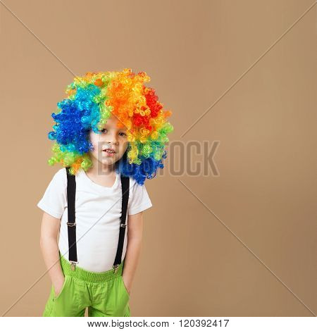 Happy Clown Boy With Large Colorful Wig