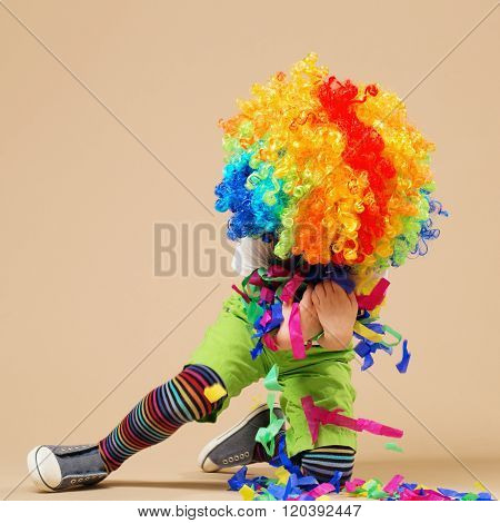 Happy Clown Boy With Large Colorful Wig.