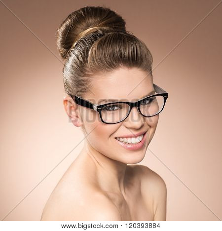 Lovely smiling young woman wearing eyeglasses in black frame