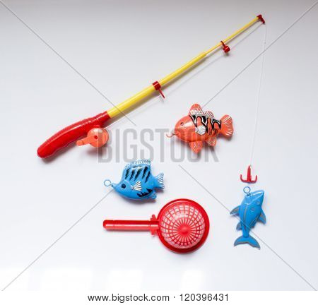 A Toy Set For Fishing With A Fishing Rod And Fish