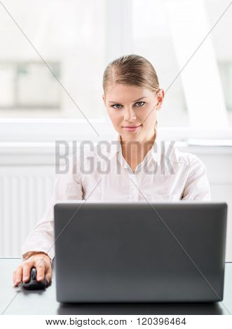 Financial career woman with laptop at the workplace