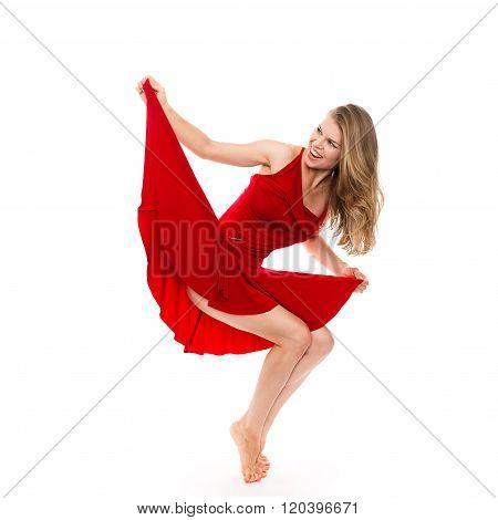 Female artist performing modern dance, standing on tiptoe