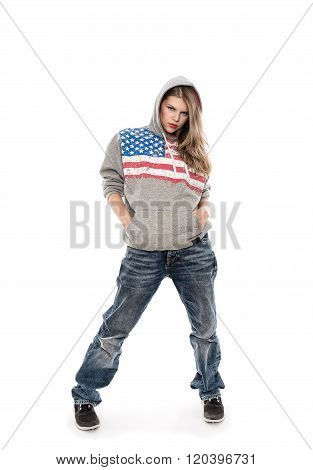 Attractive woman rapper in jeans posing in studio, isolated