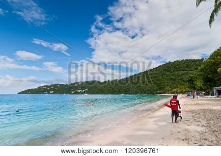 Lifeguard Patrolling The Magens Bay Beach