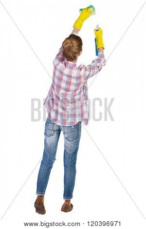Back view of a housewife in gloves with sponge and detergent. girl  watching. Rear view people collection.  backside view of person.  Isolated over white background. cleaner washes a window