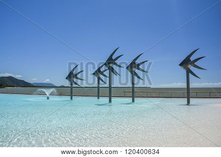CAIRNS, AUSTRALIA - SEPTEMBER 11, 2014: The famous Cairns swimming lagoon on a beautiful sunny day.