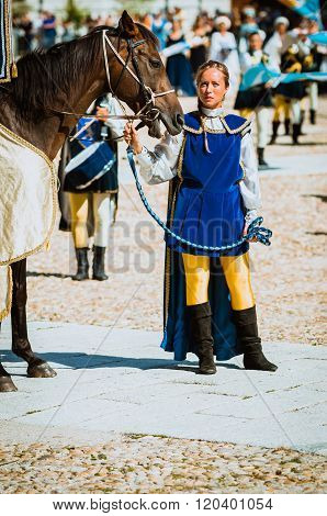 Squire Beautiful Female With Her Horse In Medieval Parade