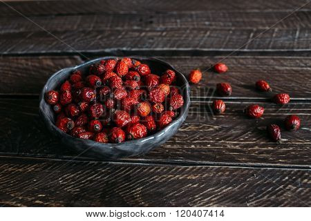 Rosehip Berries In A Clay Bowl