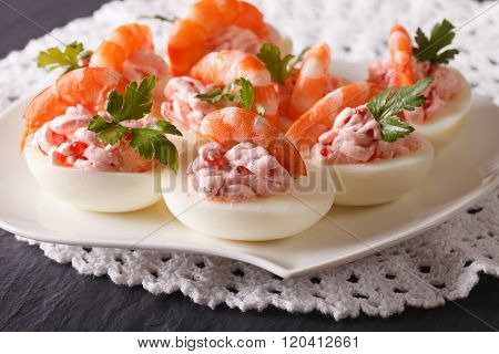 Delicious Eggs Stuffed With Seafood Close Up On A Plate. Horizontal