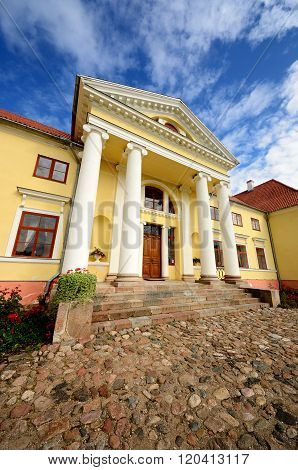 Yellow classicism style mansion. Historical Russian Empire building.
