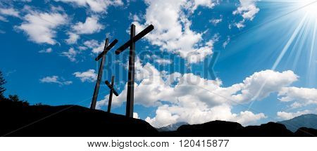 Crosses Silhouette Against Blue Sky