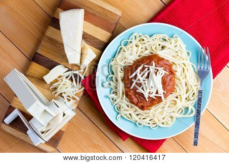 Gruyere Cheese And Spaghetti Next To Pasta Press