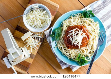 Gruyere Cheese With Pasta Press And Spaghetti