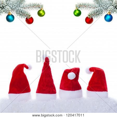 Christmas Hats And Bullets On Fir Branch