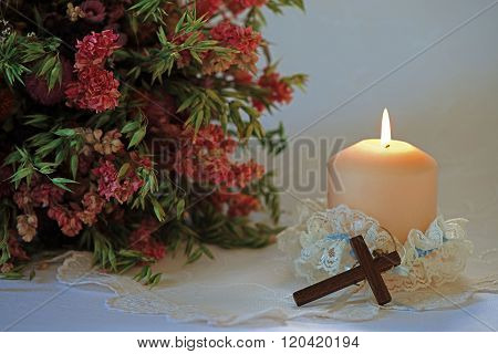 Wedding set up with flowers, candle and cross