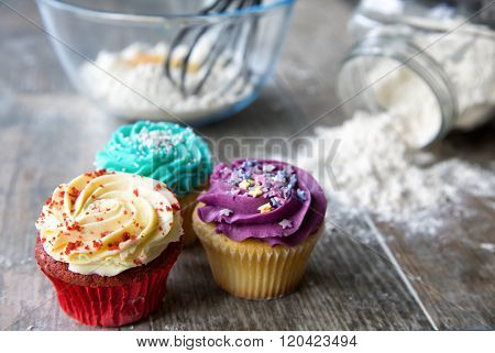 Closeup of cupcakes in front of kitchen utensils
