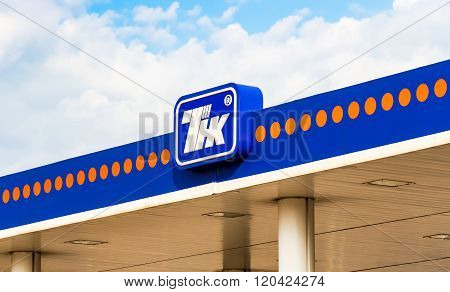 The Emblem Of The Oil Company Tnk On The Gas Station
