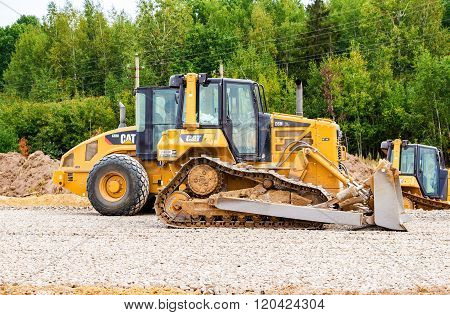 Heavy Bulldozer Loading And Moving Gravel On Road Construction Site