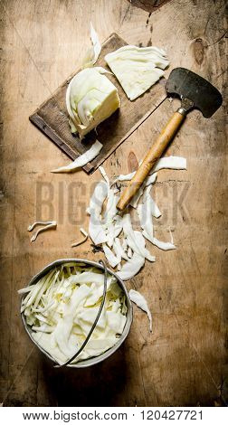 Chopped Cabbage In A Pot And An Old Hatchet.