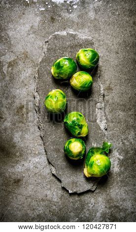 Brussels Sprouts On A Stone Stand.