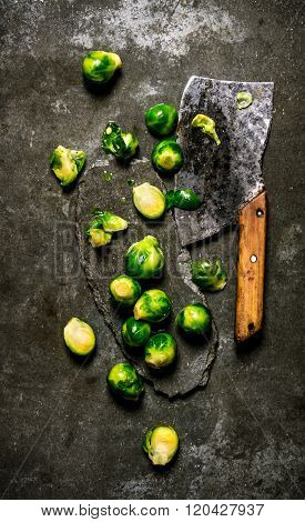 Brussels Sprouts With A Hatchet. On Stone Background.