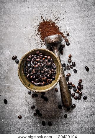 Roasted Coffee Beans In A Mortar With Pestle.