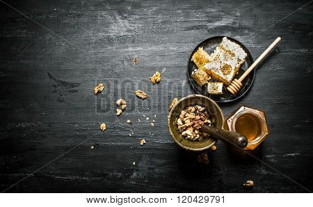 Walnuts In A Mortar And Sweet Honey