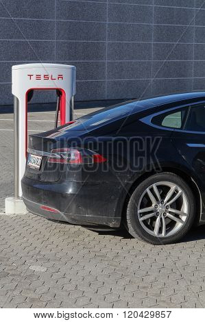 Tesla supercharger station and parking