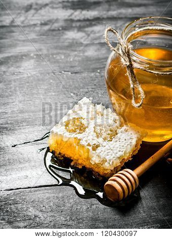 Honey Background. Natural Honey Comb And A Glass Jar.