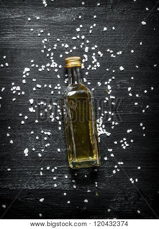 Bottle Of Olive Oil. On Black Rustic Background.