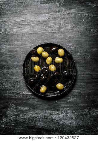 Olives And Black Olives In An Old Pan.