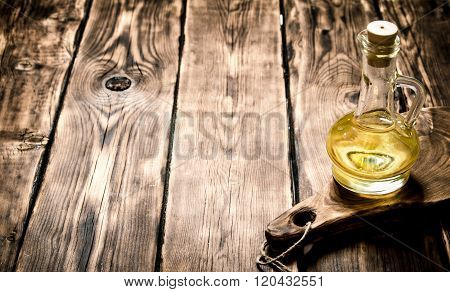 Olive Oil On Wooden Board