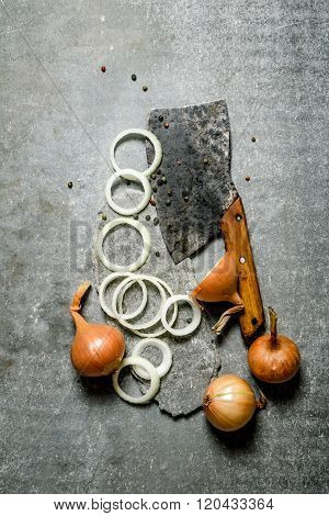 Chopped Fresh Onion And Old Hatchet On A Stone Stand.