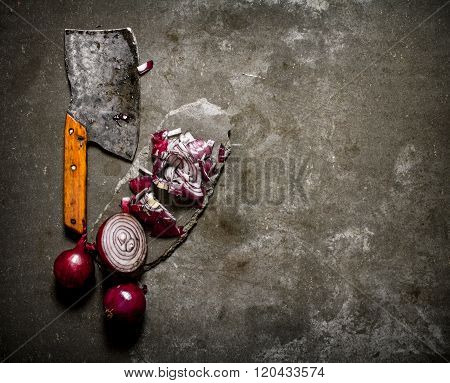 Sliced Red Onion And An Old Hatchet