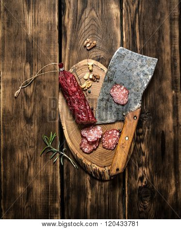 Salami And An Old Hatchet With Rosemary.