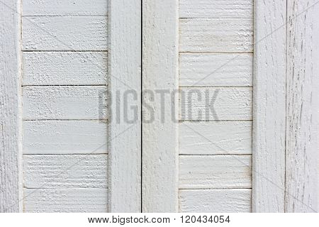 Window With Closed Beige Wooden Shutters