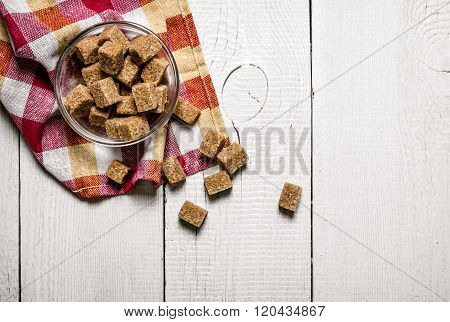 Brown Sugar In A Cup On The Napkin.