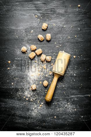 Brown Cane Sugar With Pestle.
