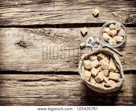 Cane Sugar Refined In The Bag. On Wooden Background.
